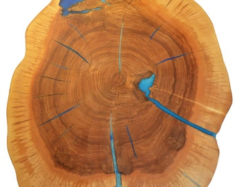Round live edge coffee table with glowing resin fillin/hairpin cooper legs