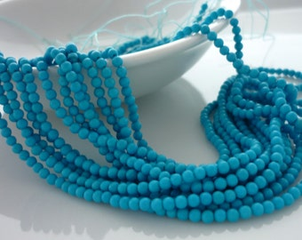 Bright blue turquoise smooth polished rounds 1.5-2mm 1/2 strand