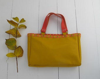 Buttercup yellow calf leather tote with gold.