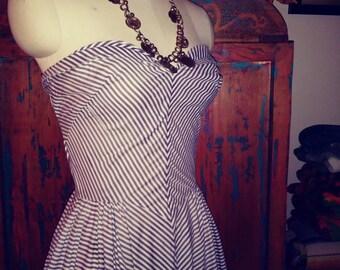 The ultimate 1950s petal bust stripey barbie sun dress.