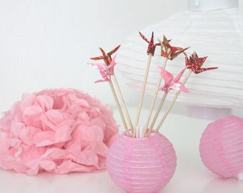 6 mini origami cranes in red and pink wooden skewers