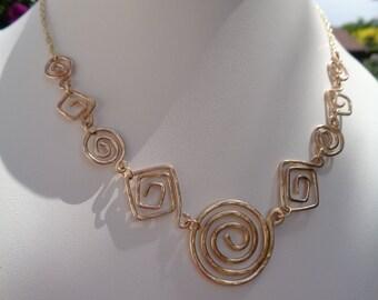Unique! Designer necklace in gold 585 with spirals in the hammer blow design
