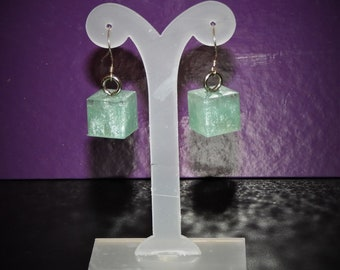 Hand made earrings in resin, silver plated hooks.