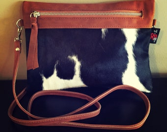 Cow Hide Sable Clutch Cross Body Bag.This quality,unique bag,cow hide one side leather the other.Strong and stylish,metal zip,long strap