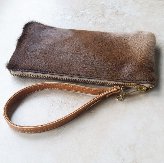 Light Brown Cowhide Wallet with card slots, phone pocket and wristlet strap - tan leather travel purse with red and grey interior