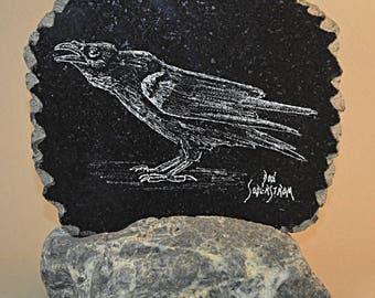 Raven hand etched on black granite