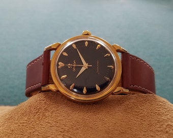 18K Omega Seamaster 471 Automatic Movement with the Original  Black Dial and Arrowhead Markers