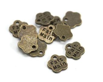 """10 mini charms with inscription """"Hand made"""" - Sun. 8 mm - Bronze color"""