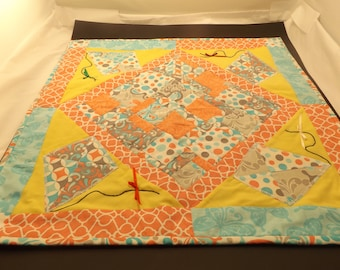Spring table runner with different kite patterns.
