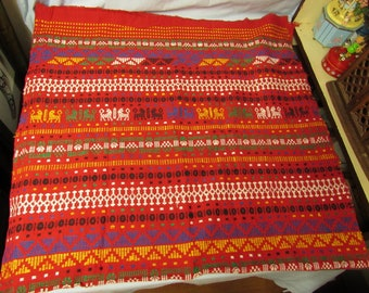 Red Peruvian Rug with Wolf designs measuring 35x68
