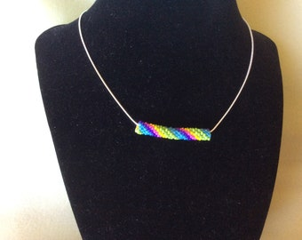 """Rainbow on a 24"""" sterling silver snake chain."""