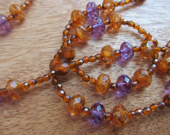 Long mysterious iridescent necklace in Mandarin, light violet and Amber