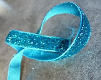 A little turquoise dangles blue glitter Ribbon