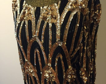 Party Staple. Black and Gold Sequin Top