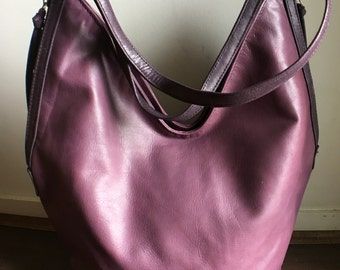 Slouchy,casual soft leather bag. Two toned and easy to open this handbag holds everything.Customise it to make it your own.Handmade leather.