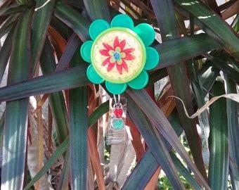 Green flower badge holder