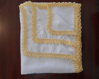 White brushed cotton receiving blanket with delicate yellow crochet trim.