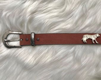 brown belt with buffalo and wolves