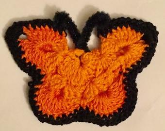 Butterfly pin, orange.
