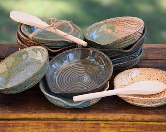 set of 10 stoneware spoon rests with wooden spoons