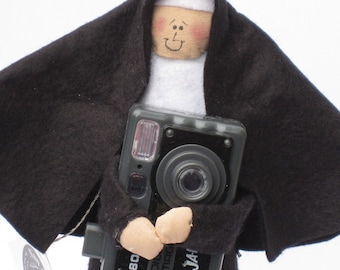 Nun doll Catholic gift photographer 'Sister Filmore'
