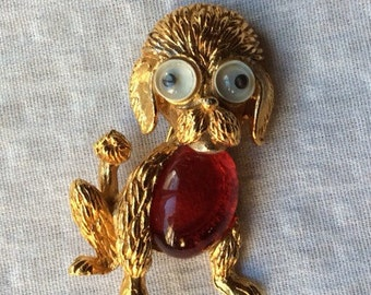 Vintage goldtone dog pin with googly eyes and red belly