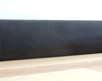 Door draft Stopper. Door or window snake. Draught excluder. House and home accessory.eco friendly energy saver. black draft stopper