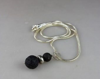lava stone necklace in a silver chain. Hand made. Reykjavik. Iceland