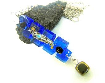 Pendentif plume sur pyrite