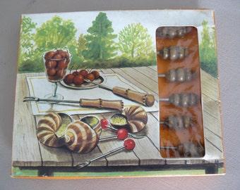 Vintage 11 snail forks in its original box.