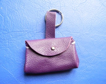 Key holder or decoration of purple leather bag