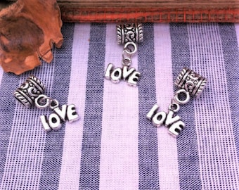 4 round bails decorated and charms: LOVE silver aged