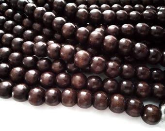 Perles rondes en bois naturel teint marron 12x11mm - 30 unités