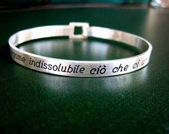 Rigid silver phrase bracelet