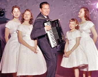 Lawrence Welk playing accordion with the Lennon Sisters.  April 1957.