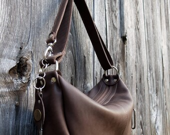 Matte brown leather with asymmetric and convertible shoulder bag
