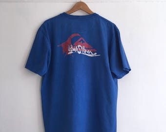 Vintage t shirt in blue. Made by Quick Sliver. Men's  size L/XL. 90's era.