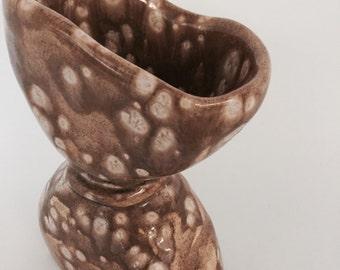 spotted ceramic vessel