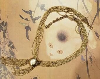 Vintage gold tassel necklace