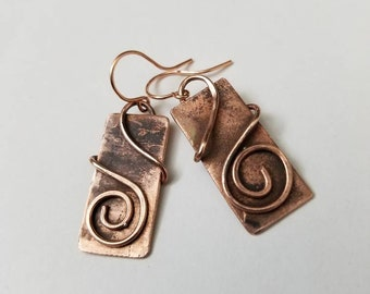 Unwinding wrapped copper wire on upcycled copper rectangle earrings