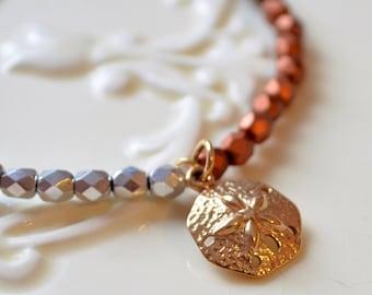 Stretch Bracelet, Czech Glass Beads, Metallic Gold Silver Copper Bronze, Sand Dollar Charm, Summer Beach Jewelry