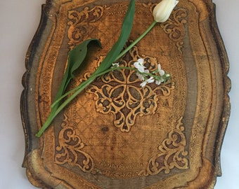 Vintage mid century gold florentine tray from Italy .