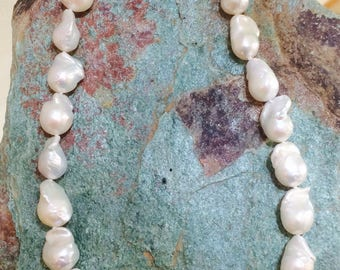 Freshwater. Baroque Pearl Necklace with 18 k White Gold buckle. Crew neckline.