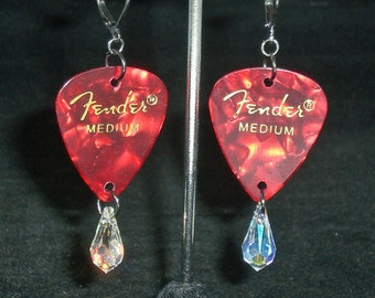 Earrings, dangle, red guitar pick with clear Swarovski teardrop crystal