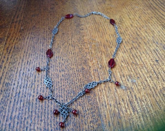 Handcrafted blackened sterling and ruby red glass neclace.