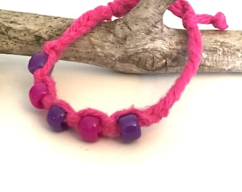 Pink and purple Beaded,  Friendship Bracelet made of Cotton with adjustable enclosures. Kids and Adults.