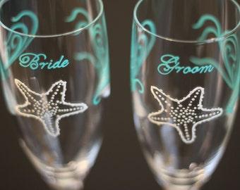 Beach Wedding Toasting Flutes Champagne Glasses Starfish Bride Groom Mr. Mrs. Partners Personalized Dated Aqua Sea Glass Blue Ivory Beige