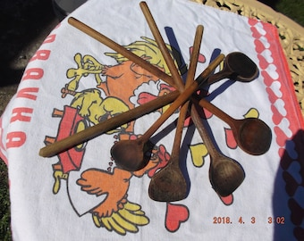 Collection of five used wood spoons