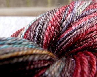 "Handspun Yarn ""Poinsettia"" Fingering SW Merino & Tencel 300 yds."
