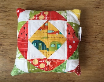 Quilted pincushion, stuffed with poly filling